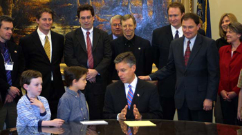 Photo: Governor Jon Huntsman signs home-education reform into law